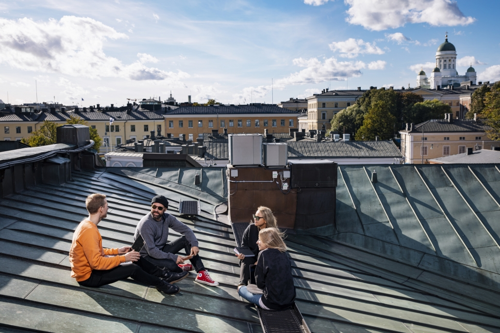People having a meeting on a rooftop